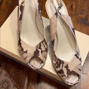 Super trendy snakeskin peep toe heels